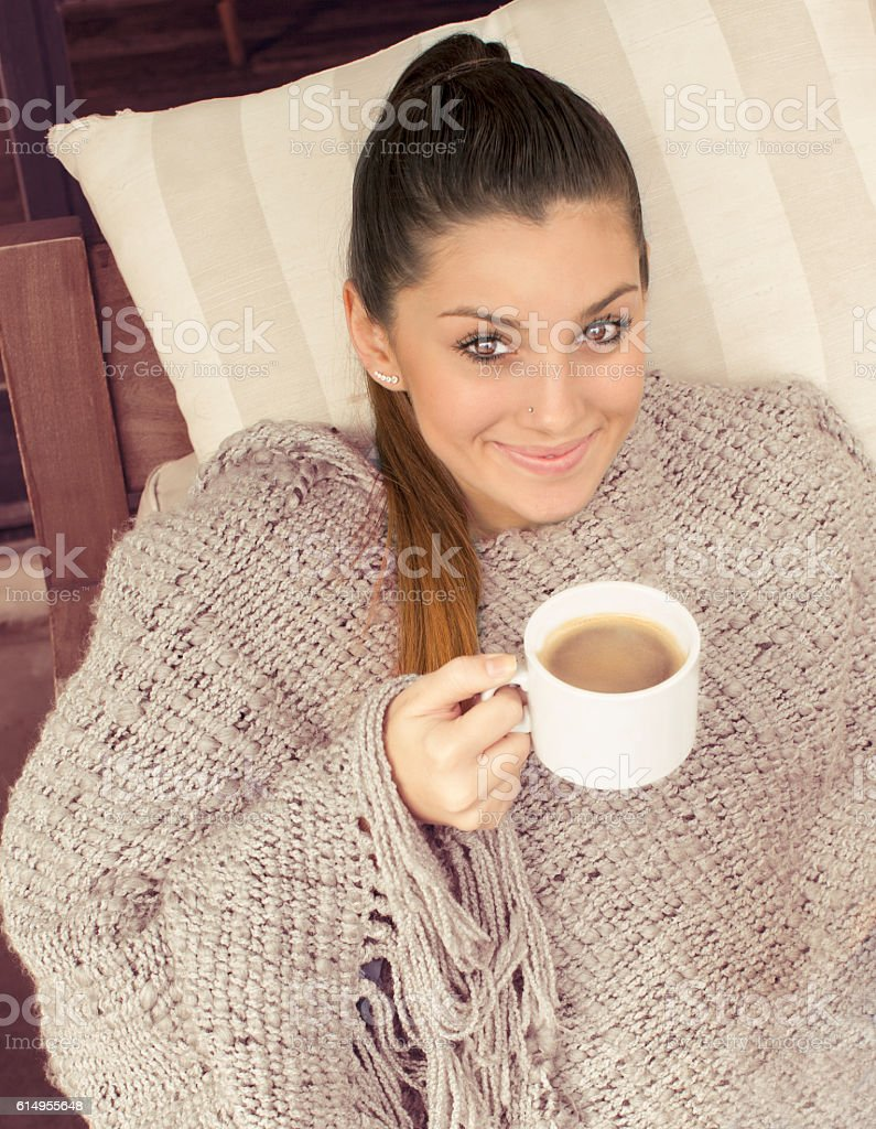Young woman drinking coffee stock photo