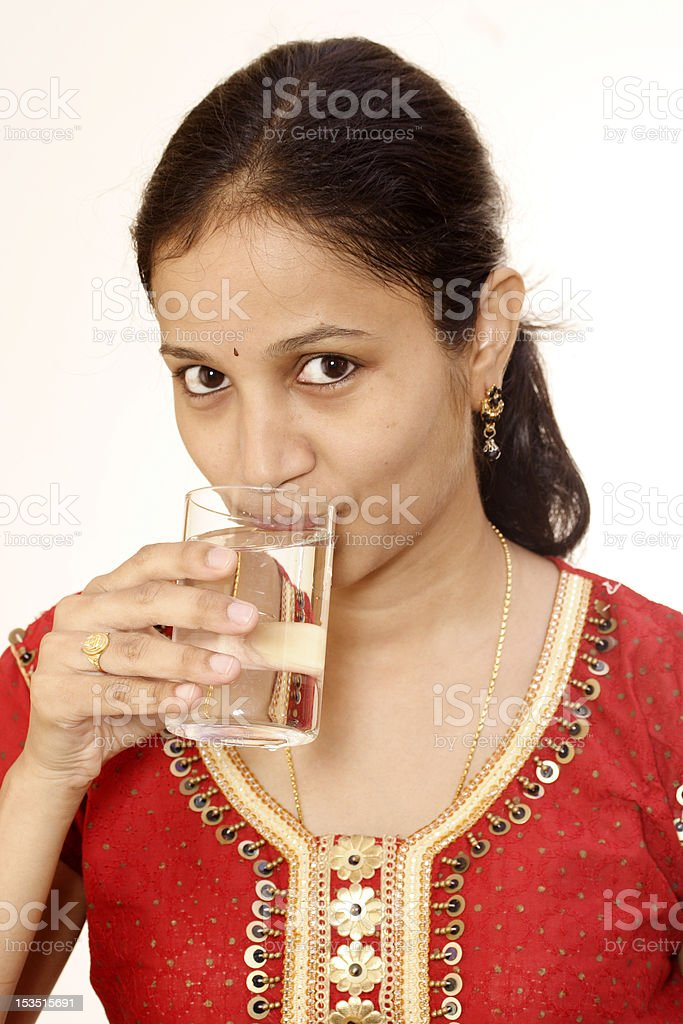 Young woman drinking fresh cold water stock photo