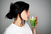 Young woman drinking healthy detox