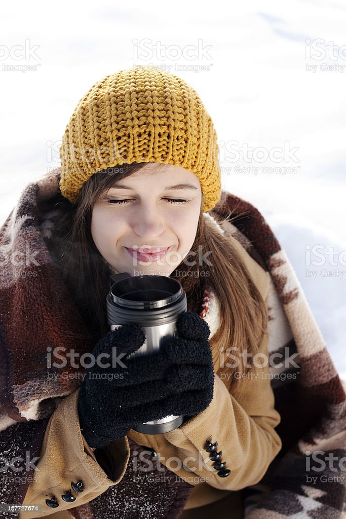 Young woman drinking hot drink outdoors royalty-free stock photo