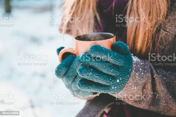 Photo of Young woman drinking hot drink