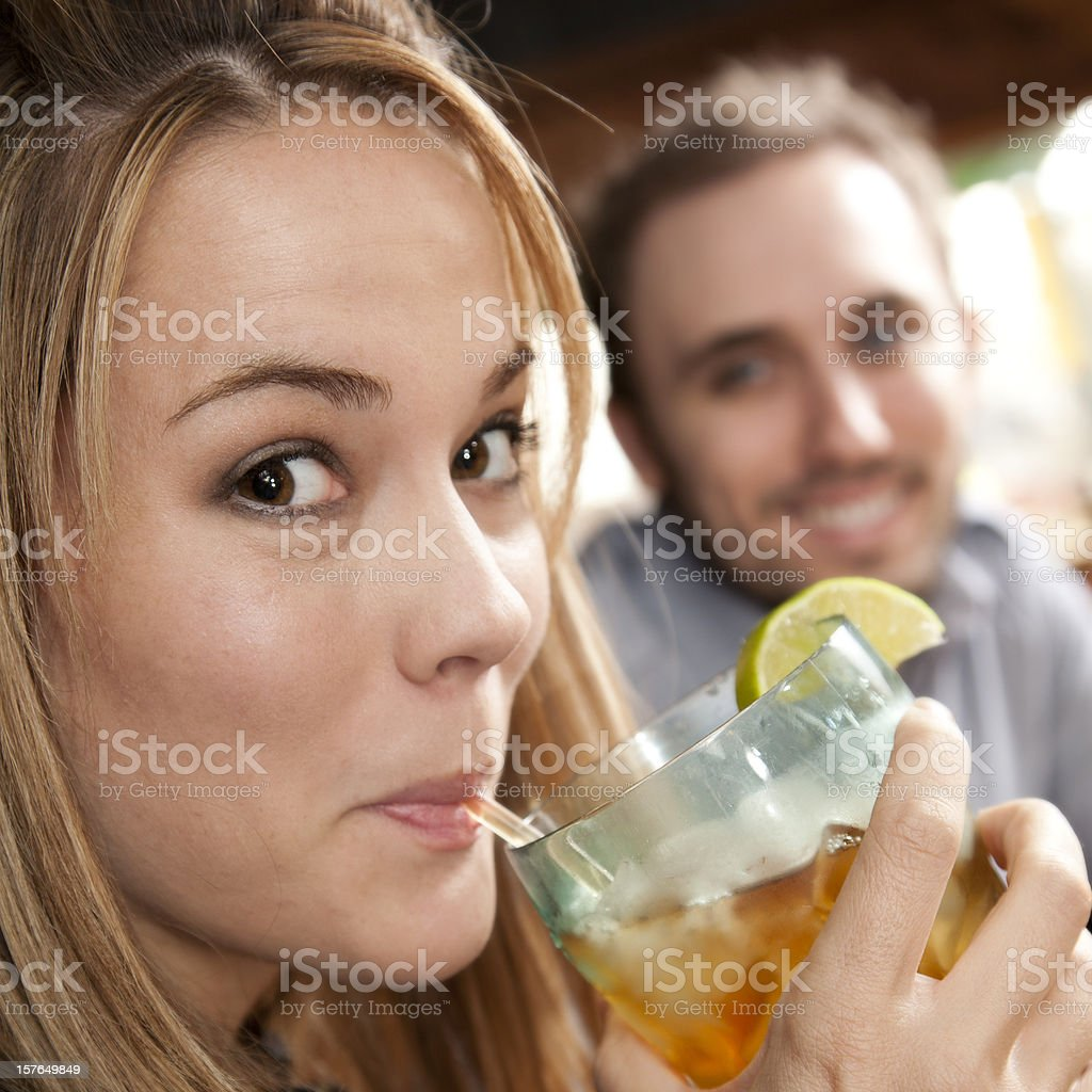 Young Woman Drinking Iced Drink With Her Husband at Restaurant royalty-free stock photo