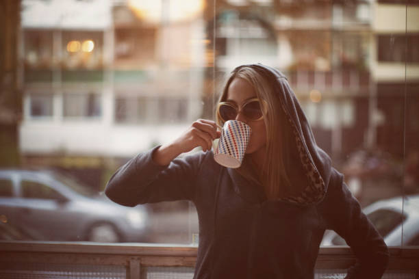Young woman drinking late morning coffee Young woman drinking late morning coffee. aftereffect stock pictures, royalty-free photos & images