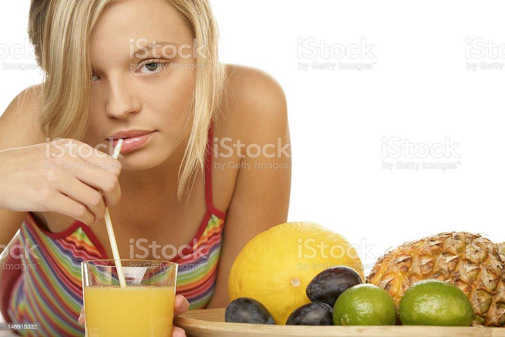 Young woman drinking orange juice royalty-free stock photo