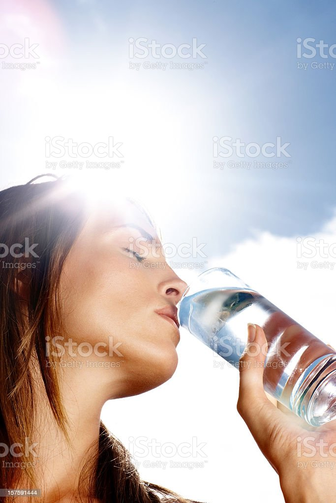 Young woman drinking water on a sunny day royalty-free stock photo