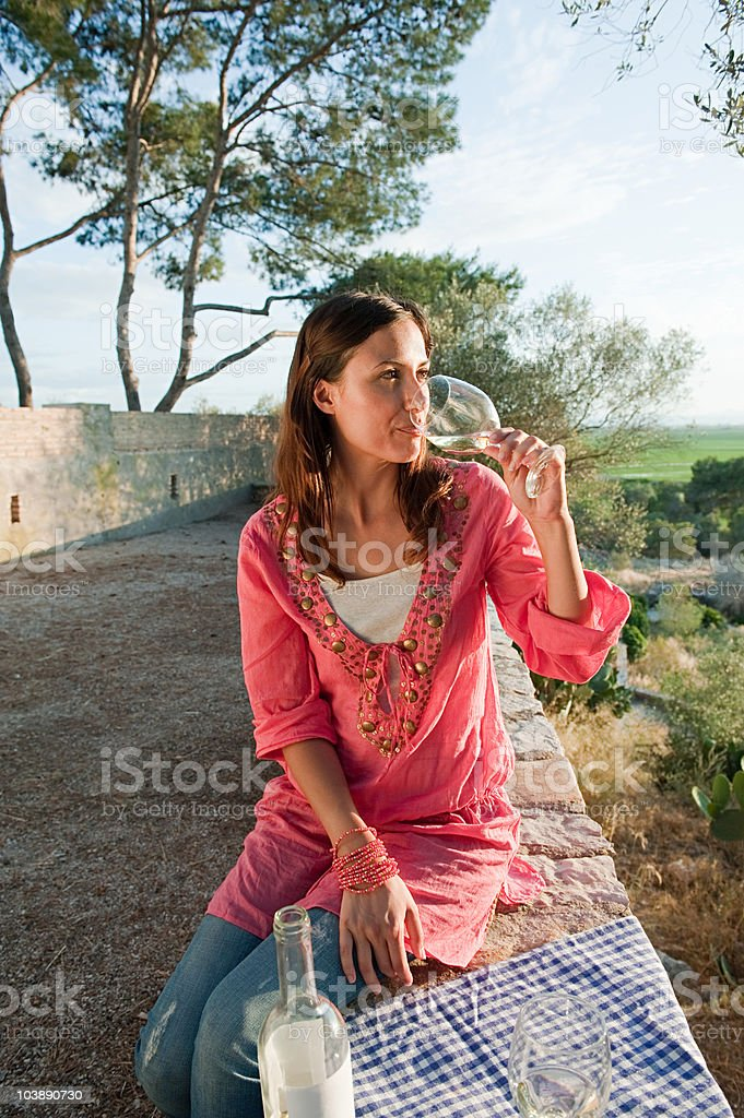 Young woman drinking wine on holiday royalty-free stock photo