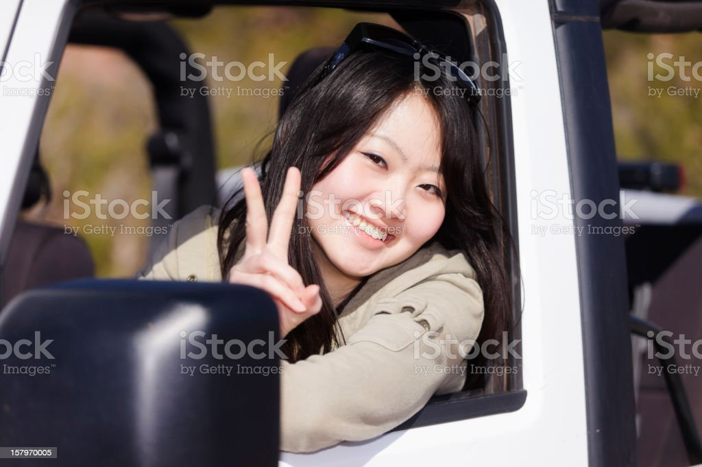 Young Woman Driving an Off Road Vehicle royalty-free stock photo