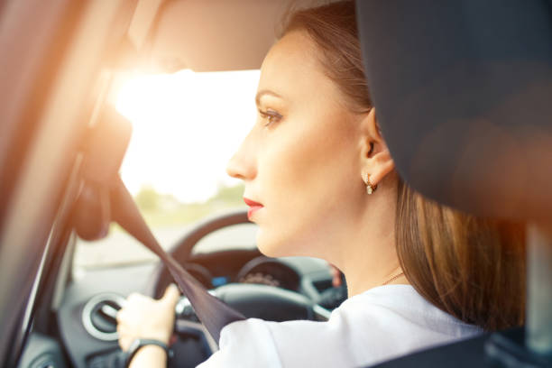 Young woman driving car in travel vacation Young business woman driving car in travel vacation sergionicr stock pictures, royalty-free photos & images