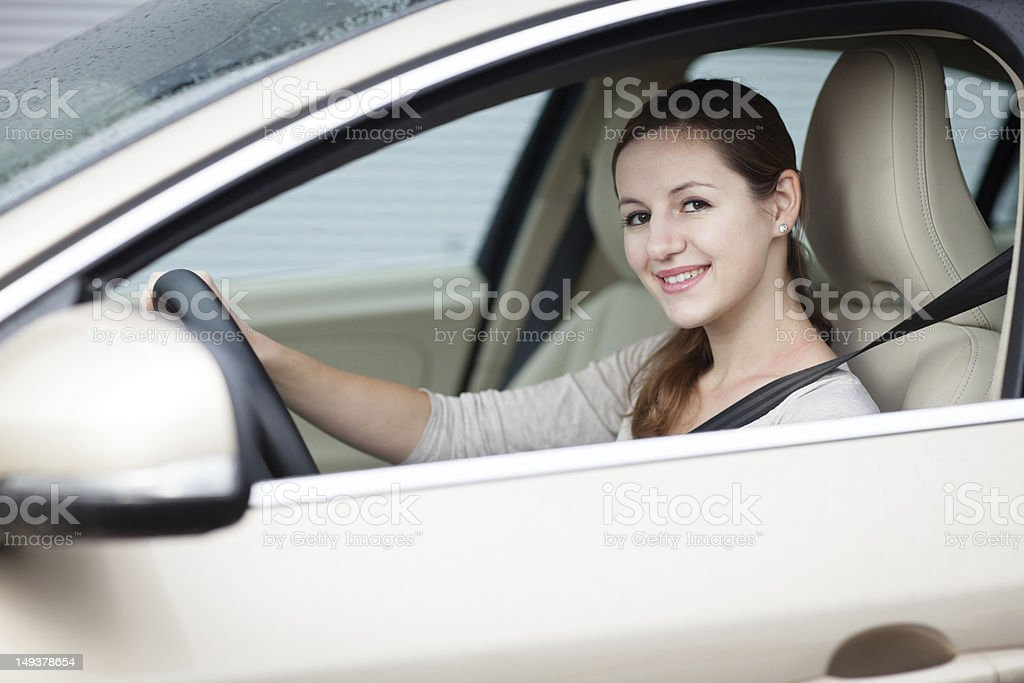 Young woman driving her new car stock photo