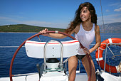 Young woman driving the sailboat