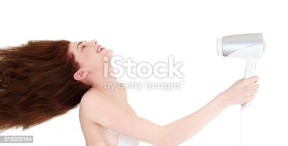 639833996istockphoto Young woman drying her hair 515003184