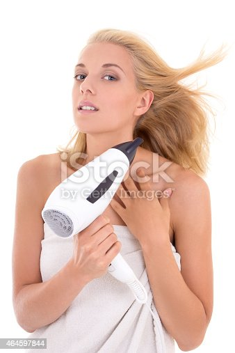 639833996istockphoto young woman drying her hair with hairdryer 464597844