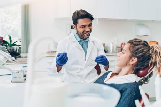 young woman during a dental check-up - dentist zdjęcia i obrazy z banku zdjęć