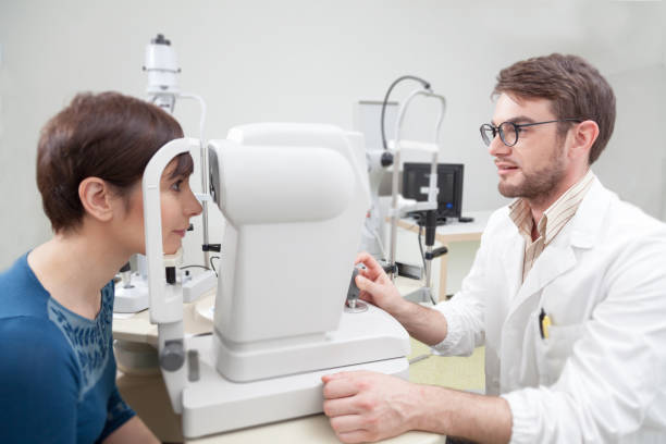 Young woman during an eye exam with the ophthalmologist stock photo