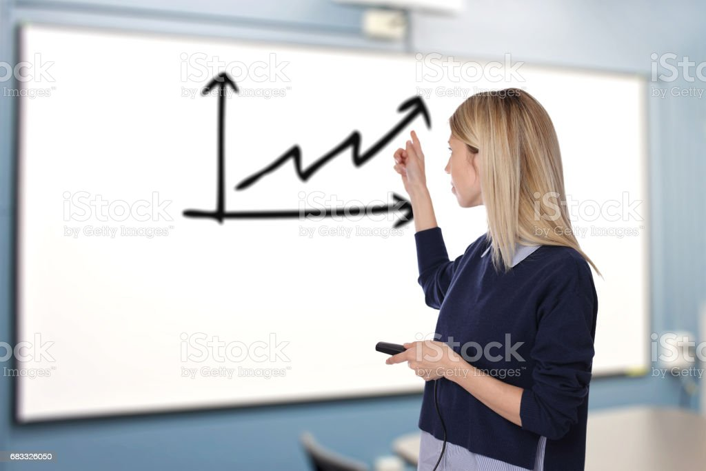 Young woman during Conference / Business Meting presents Project results with chart or infographic foto stock royalty-free