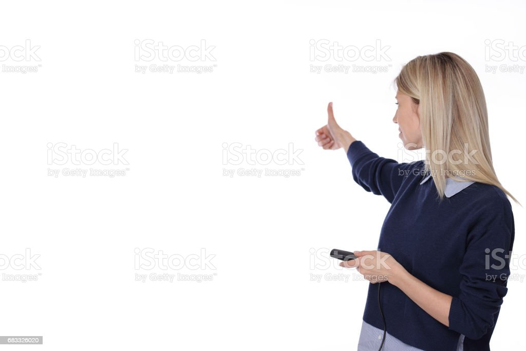 Young woman during Conference or Business Meting showing thumbs up isolated on white background, copy space royalty-free stock photo