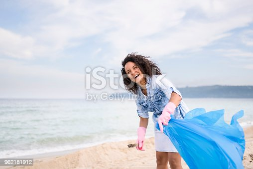 962184460 istock photo Young woman during local clean up 962181912