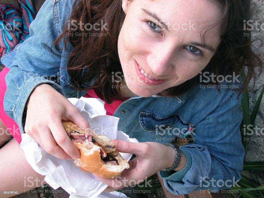 Young woman eating a Burger royalty-free stock photo