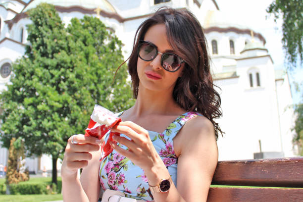 Young woman eating an ice cream picture id965691646?b=1&k=6&m=965691646&s=612x612&w=0&h=b5iojhvdl5s8t8tfpvcwgllujnb8wucs hxttlewccs=