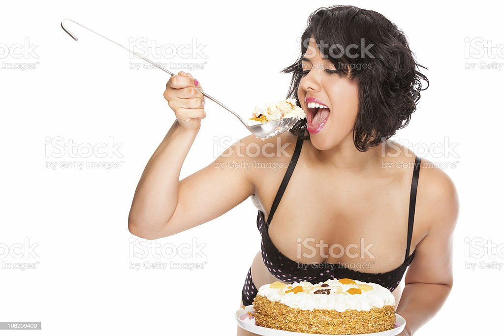 Young woman eating birthday cake stock photo