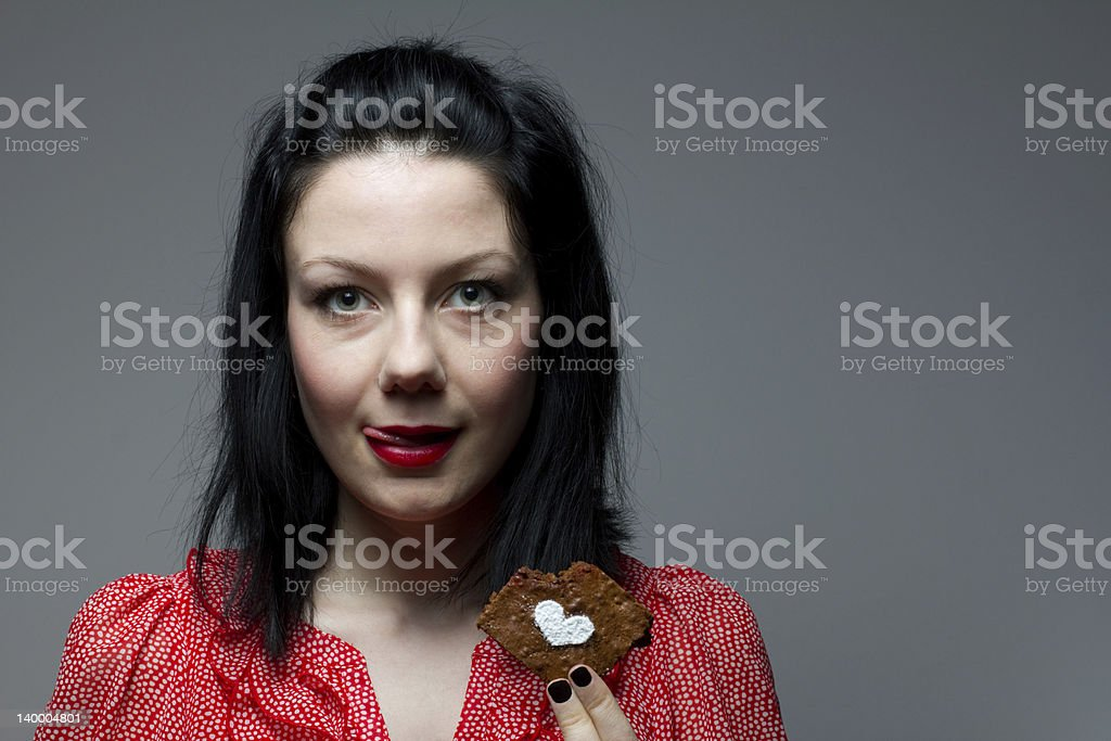 Young woman eating brownie royalty-free stock photo