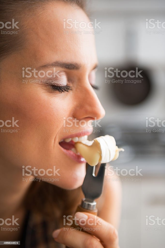 young woman eating camembert Young woman eating camembert 2015 Stock Photo