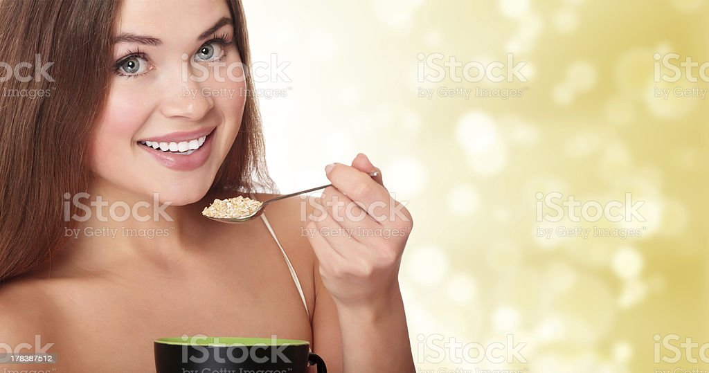 young woman eating corn flakes stock photo
