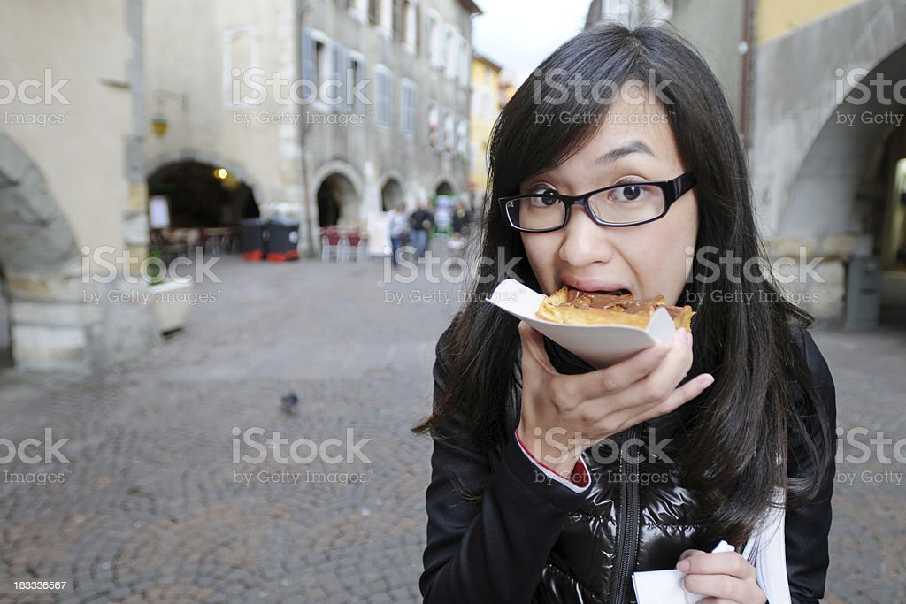 Young Woman Eating Food At Outdoors - XLarge stock photo
