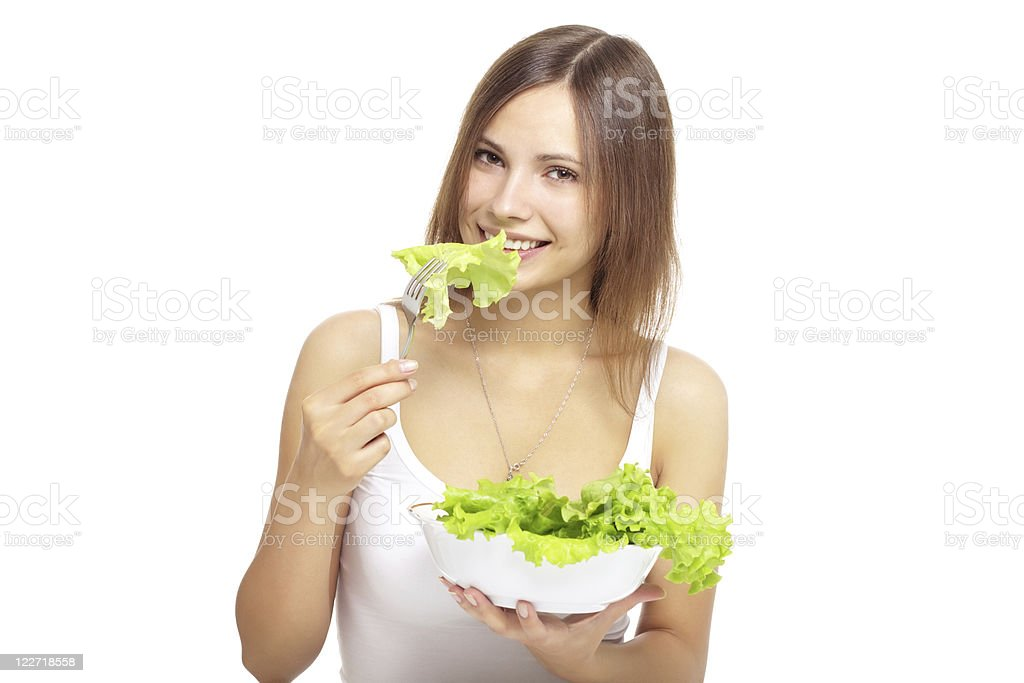 Young woman eating healthy salad royalty-free stock photo