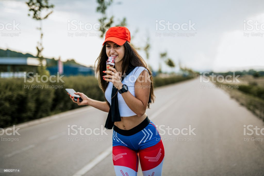 Young woman eating her favorite ice cream royalty-free stock photo