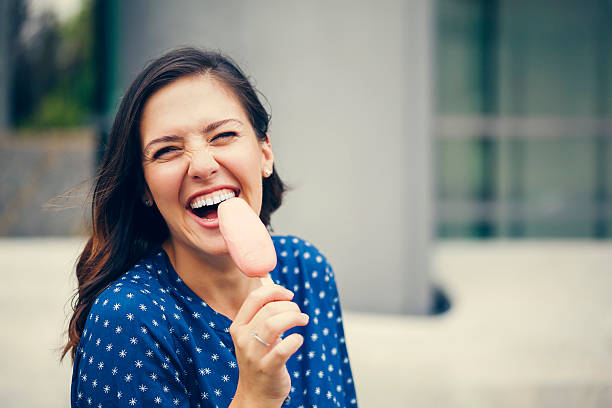 Young Woman Eating Ice Cream stock photo