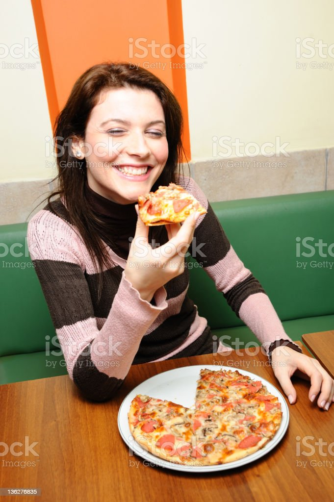 Young woman eating pizza royalty-free stock photo