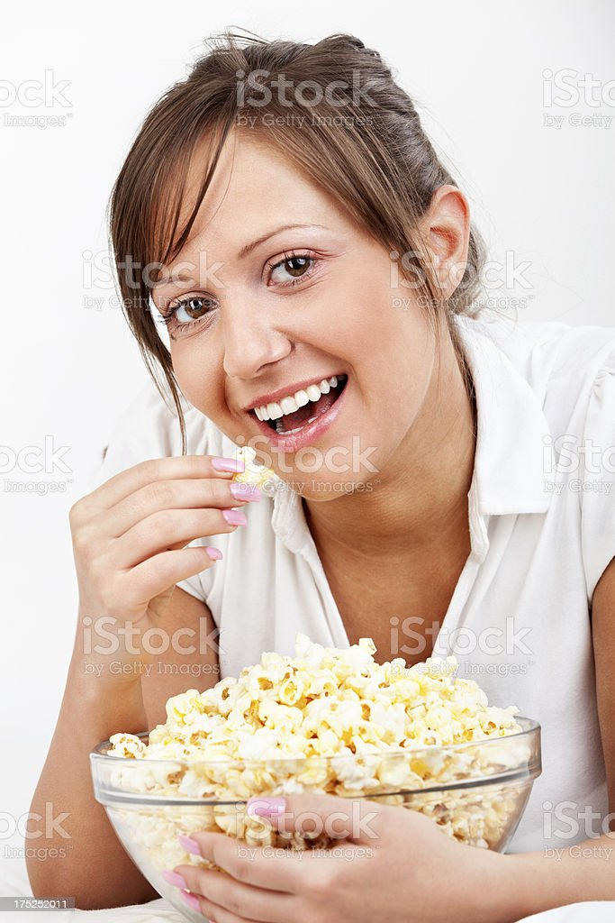 Young woman eating popcorn royalty-free stock photo