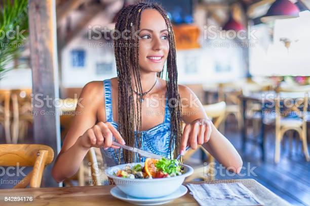 Young woman eating salad in restaurant picture id842894176?b=1&k=6&m=842894176&s=612x612&h=sijptlu3lkw vqlkpgv55ynzm4ky0e3liqr1aazx1de=