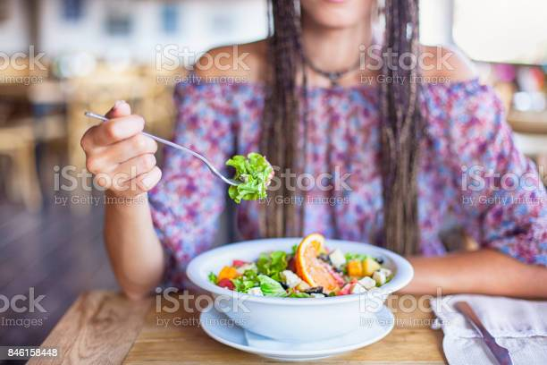 Young woman eating salad in restaurant picture id846158448?b=1&k=6&m=846158448&s=612x612&h=slbks7vufgzsgkpsb2ifi9cjnl2fpfheuryrorbhsoc=