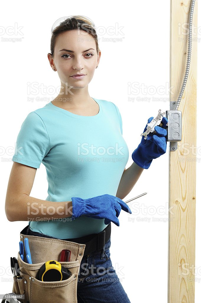 Young Woman Electrician Installing Electrical Switch with Screwdriver on White royalty-free stock photo