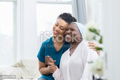 932074776istockphoto Young woman embraces ill mother 932074784