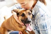 istock Young Woman Embracing Dog 1142921675