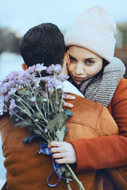 Young woman embracing her boyfriend stock photo