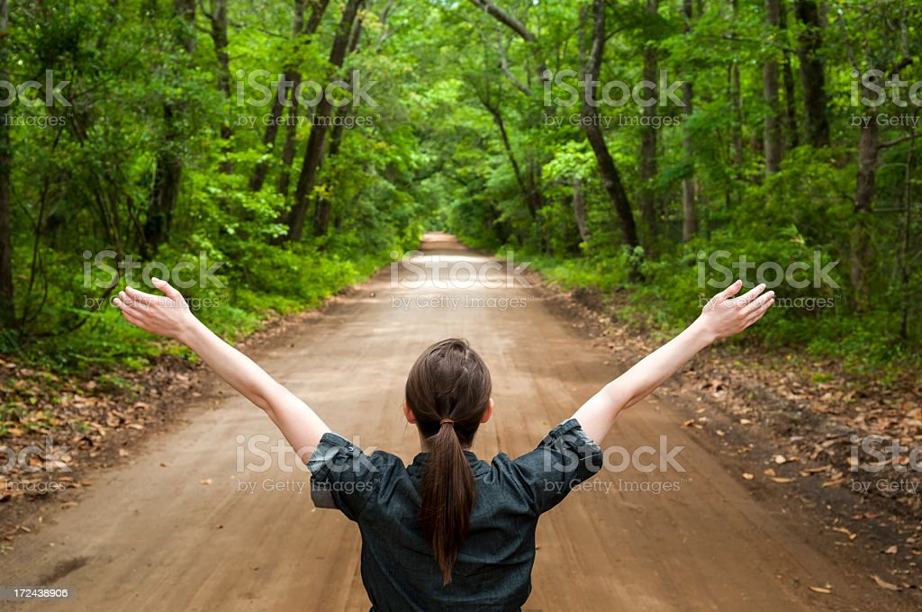 Young woman embracing the open road stock photo