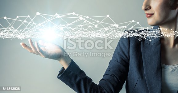 istock young woman engineer holding her hand under a 3D object. 3D rendering graphics. abstract mixed media. 841843906