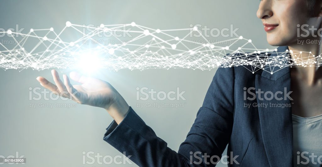 young woman engineer holding her hand under a 3D object. 3D rendering graphics. abstract mixed media. stock photo