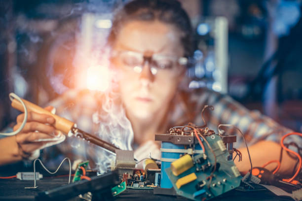 Young woman engineer Young woman engineer working on project soldering iron stock pictures, royalty-free photos & images