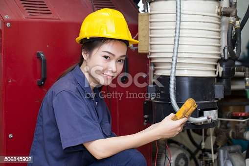 688536850 istock photo young woman engineer setup testing machine 506845902