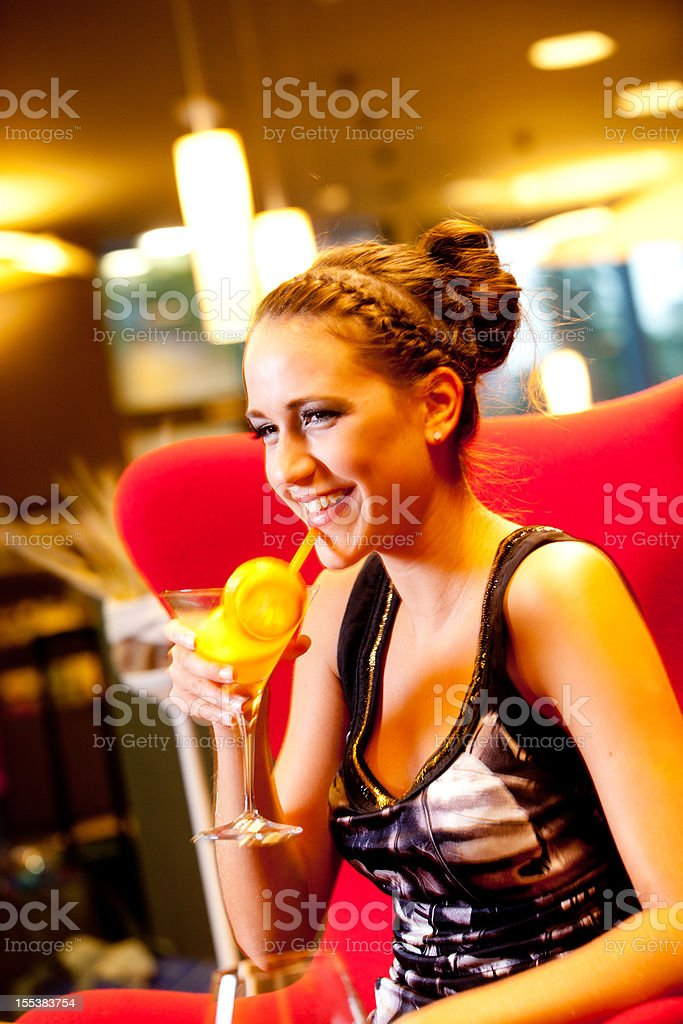 Young woman enjoying a cocktail stock photo