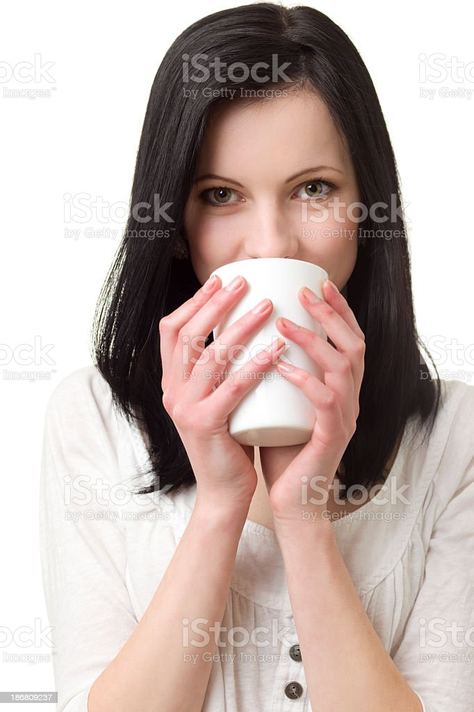 Young woman enjoying A Cup Cappuccino royalty-free stock photo