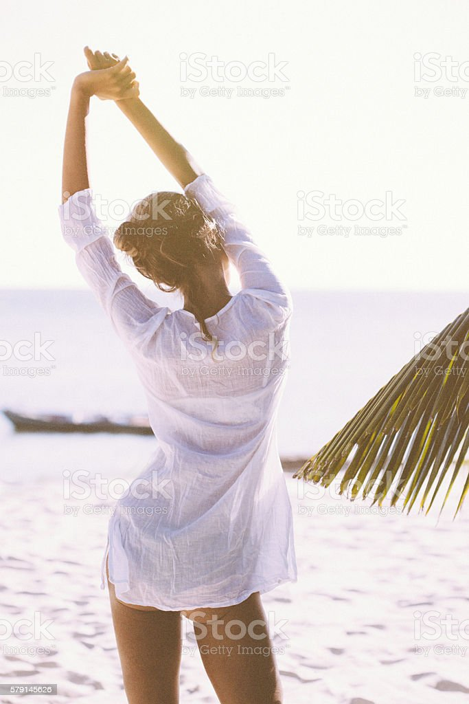 Young woman  enjoying a day at the beach stock photo
