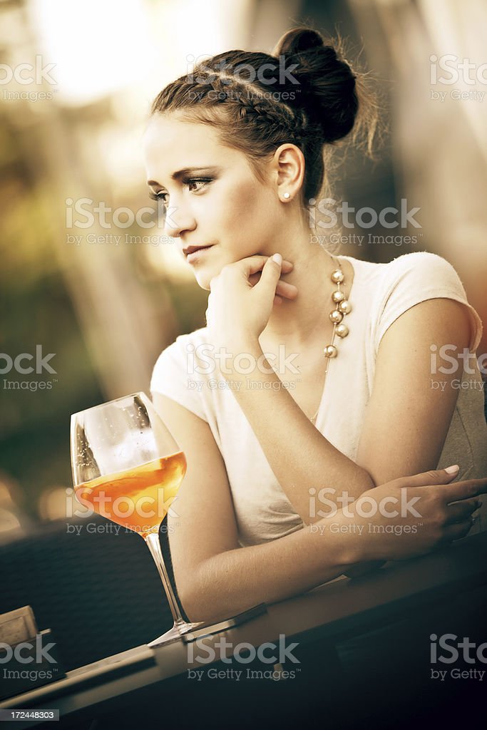 Young woman enjoying a drink royalty-free stock photo