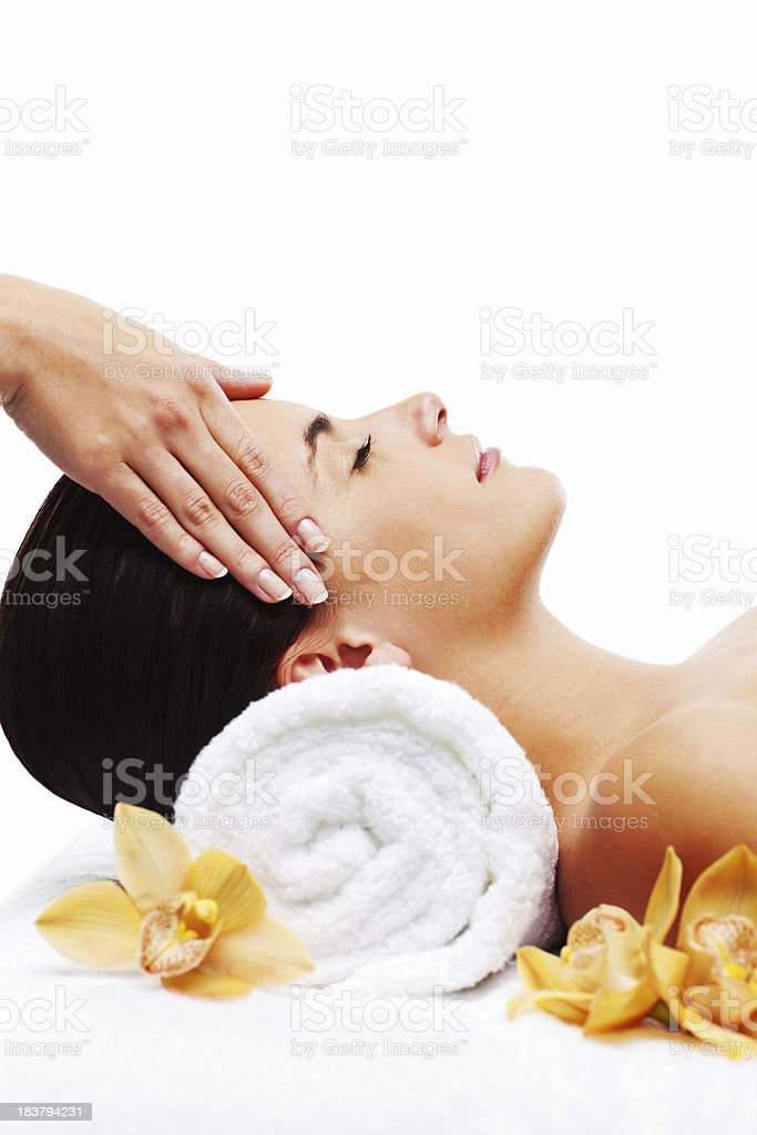 Young Woman Enjoying a Head Massage royalty-free stock photo