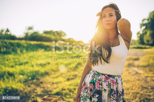516318379 istock photo Young woman enjoying a sunny day in the nature 874225916